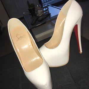 Christian Louboutin heels .